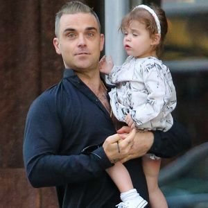Photo of Robbie Williams & his  Daughter  Theodora Rose Williams