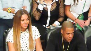 Beyoncé und Ja-Z sitzen nebeneinander