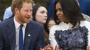 Prinz Harry und Michelle Obama unterhalten sich