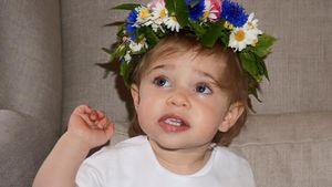 Prinzessin Leonore von Schweden mit einem Blumenkranz