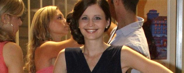 Katharina Woschek mit Golfschläger