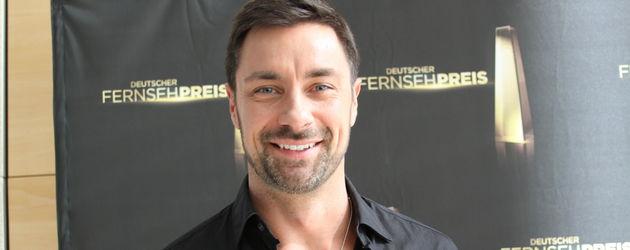 Marco Schreyl lächelt