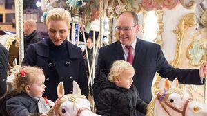 Fürstin Charlene und Fürst Albert mit ihren Zwillingen auf dem Weihnachts-Karussell