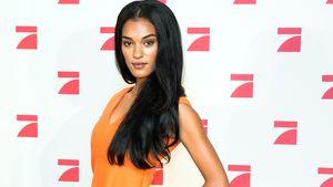 GNTM.-Jasmin im orange farbenen Kleid