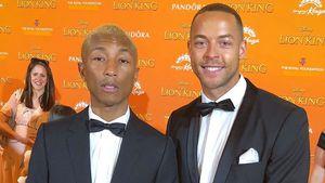 Auf UK-Premiere: Andrej Mangold trifft Pharrell Williams