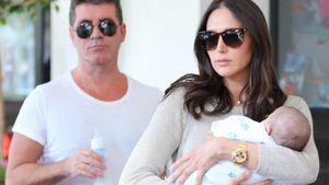 Süße Baby-Bilder: Simon Cowell mit Eric unterwegs
