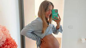 Hochschwangere Steph Claire Smith tanzt ausgelassen herum
