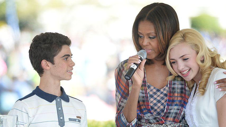 Cameron Boyce, Michelle Obama und Peyton List im April 2014