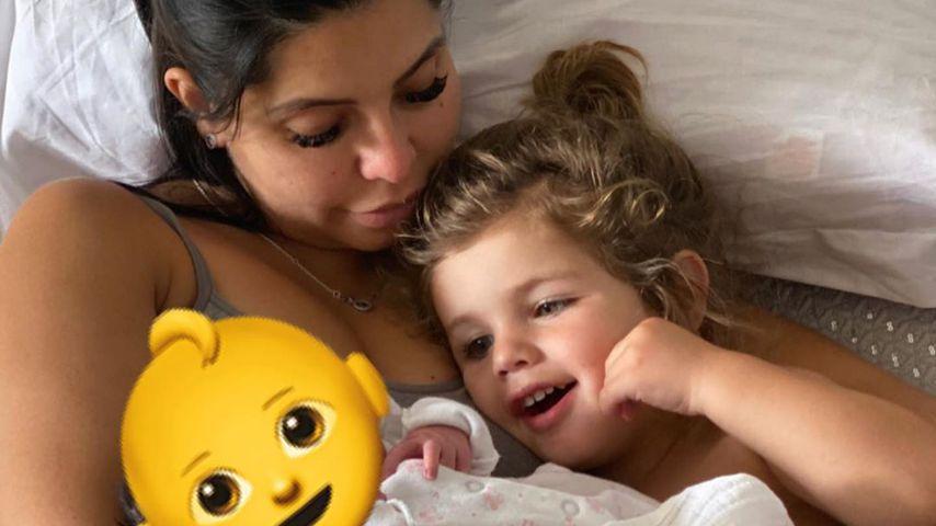 Cara de la Hoyde mit ihren beiden Kindern
