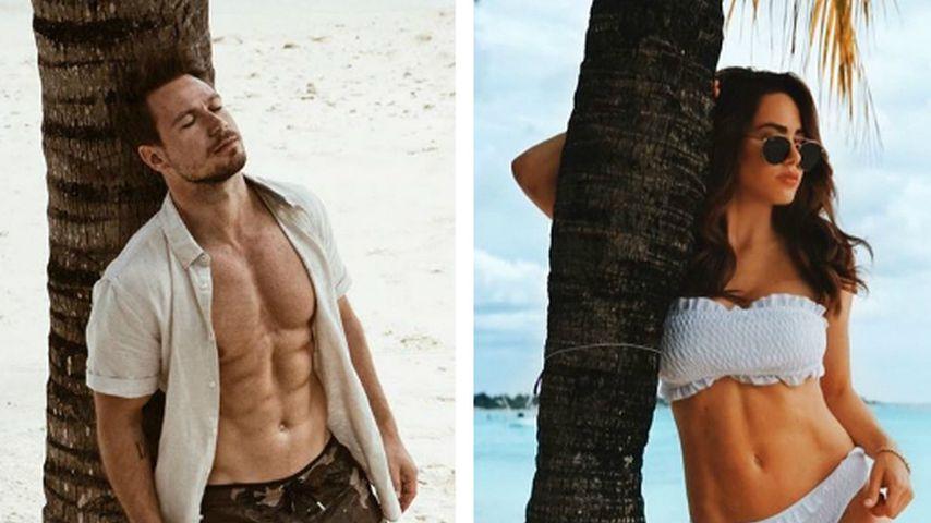 Basti Pannek & Angelina posieren in derselben Pose am Strand
