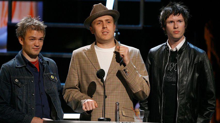 Deryck Whibley, Steve Jocz und Jason McCaslin von der Band Sum 41