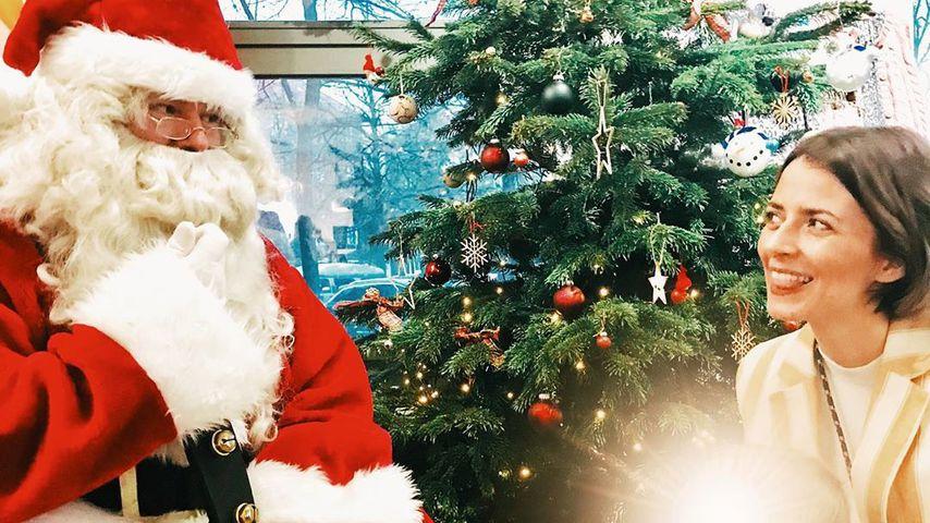 Eva Padberg mit ihrer Tochter beim Weihnachtsmann