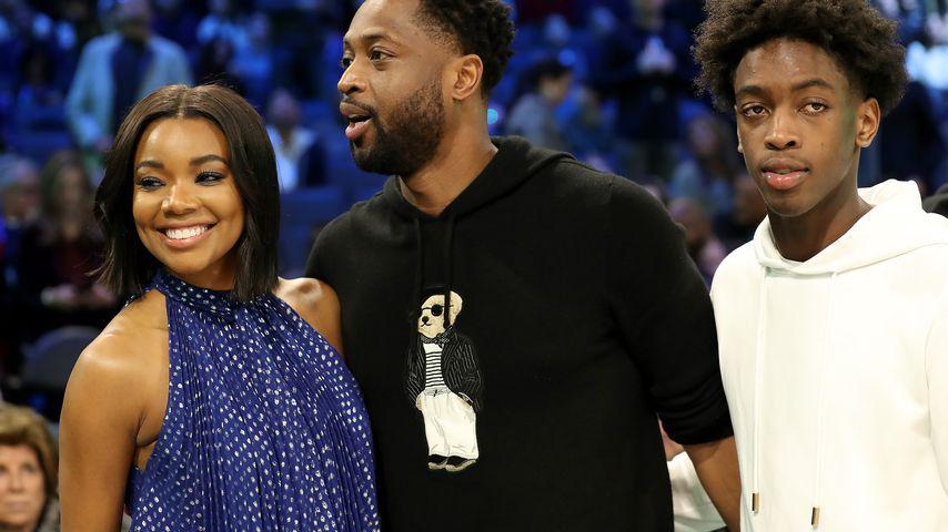 Gabrielle Union, Dwyane Wade und sein Sohn Zaire bei einem Basketballspiel im Februar 2019
