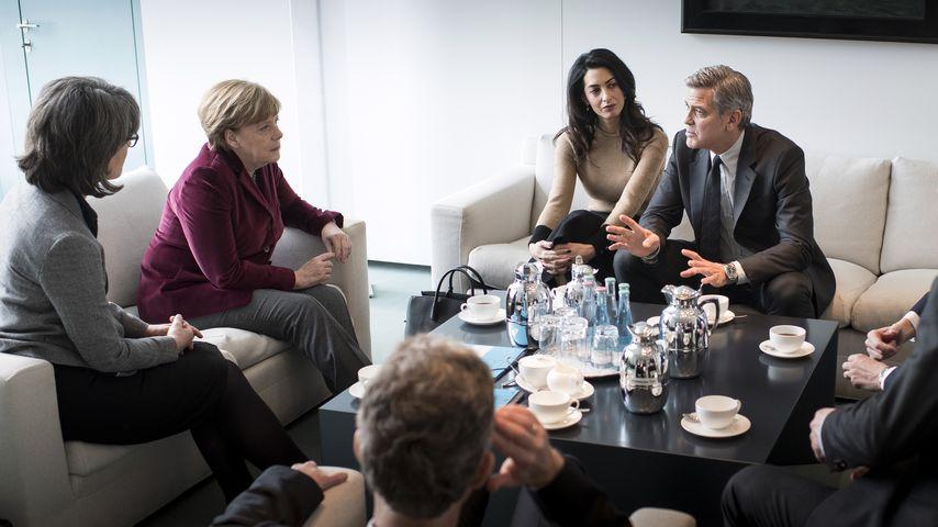 George Clooney, Amal Alamuddin und Angela Merkel