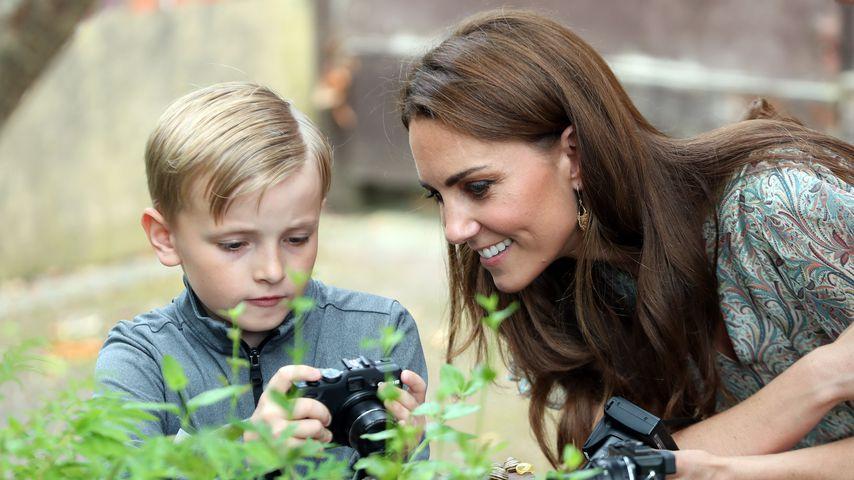 Herzogin Kate mit einem Kursteilnehmer eines Foto-Workshops