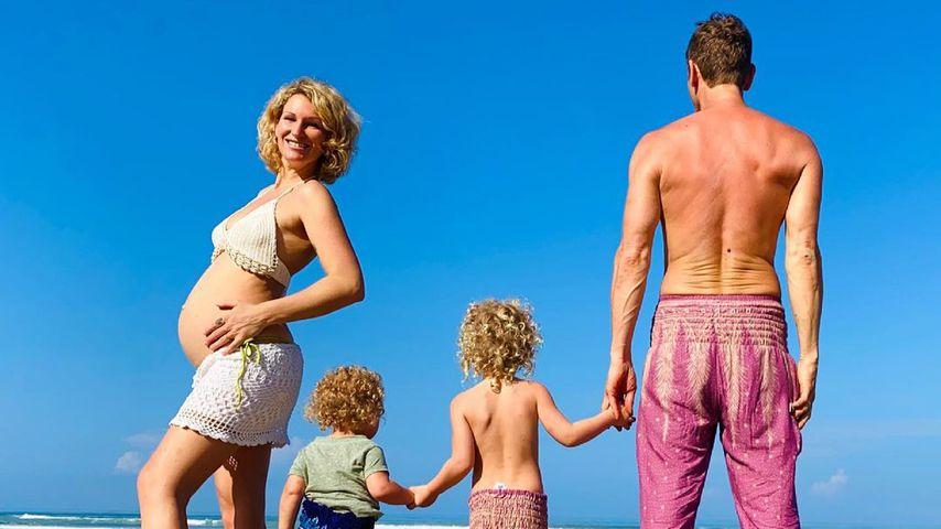 Janni und Peer Kusmagk mit ihren zwei Kindern, 2021