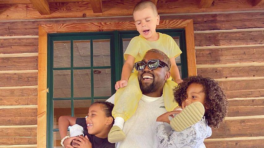 Kanye West mit seinen Kindern North und Saint und seinem Neffen Reign