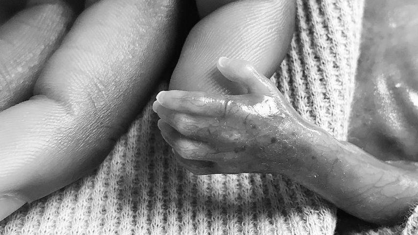 Marquise Goodwin und die Hand seines Sohnes