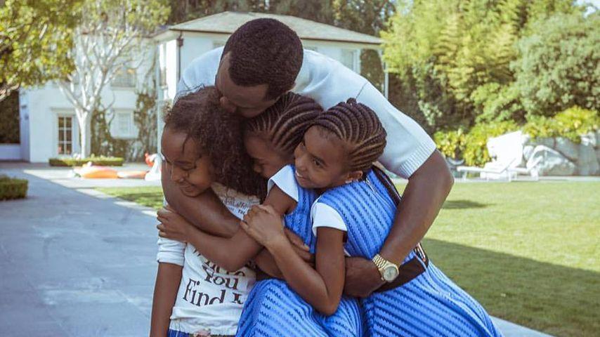 US-Rapper Sean Combs alias P. Diddy mit seinen drei Töchtern