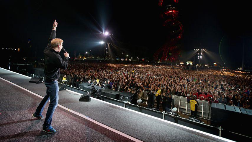 Prinz Harry auf einer Bühne in London 2014