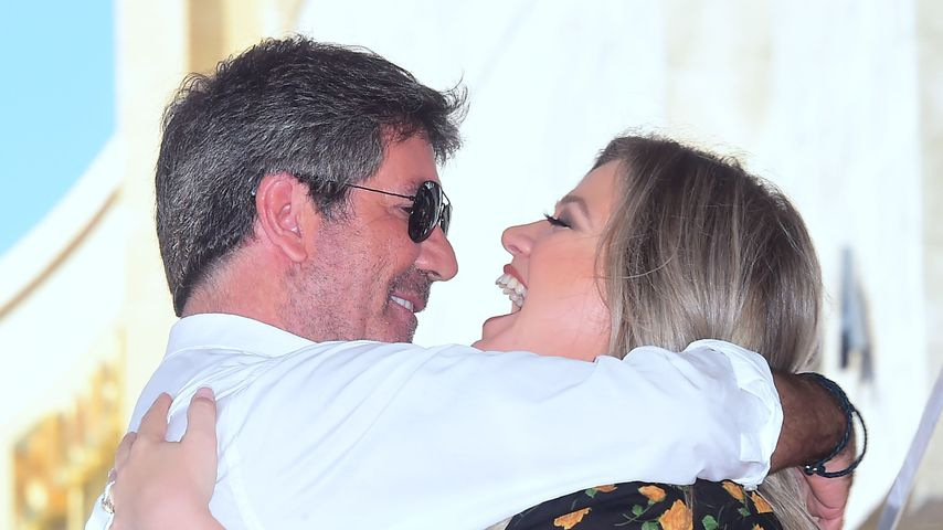 Simon Cowell und Kelly Clarkson bei der Verleihung von Simons Stern auf dem Walk of Fame
