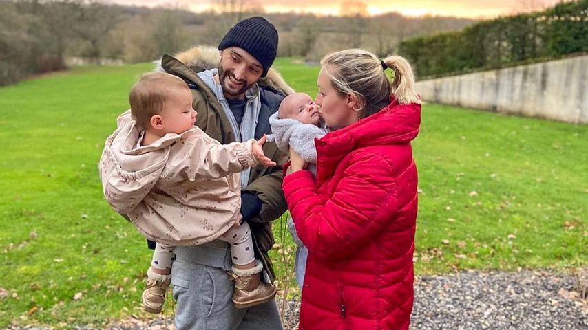 Tom Parker, seine Frau Kelsey und ihre zwei Kinder