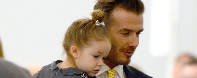 David Beckham (r.) mit seiner Tochter Harper bei der Fashion Week in New York